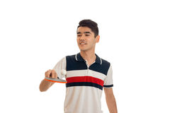 Cheerful young brunett man playing ping-pong isolated on white background. Cheerful young brunett man playing ping-pong isolated on white royalty free stock photo