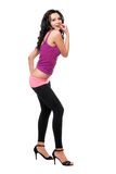 Cheerful young brunette in a black leggings Royalty Free Stock Photography