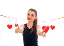 Cheerful young brunette girl posing with red heart isolated on white background. Saint Valentines Day concept. Love Royalty Free Stock Images
