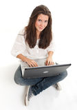 Cheerful young brunette and laptop Royalty Free Stock Images