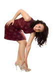 Cheerful young brunette in red dress Royalty Free Stock Photography