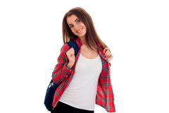 Cheerful young brunette student girl with blue backpack posing and looking at the camera and smiling isolated on white Royalty Free Stock Photo