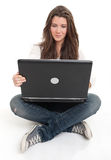 Cheerful young brunette using laptop Stock Images