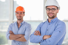 Cheerful young builders are working on a project Stock Photo