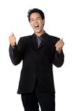 Cheerful young business man with clenched fist. Business man with clenched fist isolated Royalty Free Stock Images