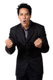 A cheerful young business man with clenched fist  isolated Stock Image