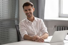 Free Cheerful Young Business Man Laughing Sitting At Work Office Desk Stock Image - 153897361