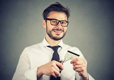 Happy man cutting credit card Stock Photo