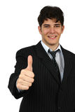 Cheerful young business man showing thumb up sign Royalty Free Stock Photo