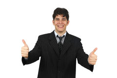 Cheerful young business man showing thumbs up sign Stock Image