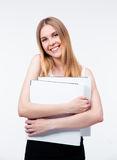 Cheerful young business woman holding folders Royalty Free Stock Photos