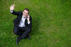 Cheerful young businessman calling by phone Stock Image