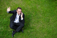 Cheerful young businessman calling by phone Stock Photography