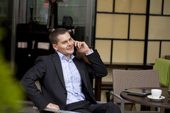 Cheerful young businessman calling by phone Royalty Free Stock Images