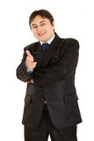 Cheerful young businessman with gun shaped hand Stock Images
