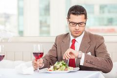 Cheerful young businessman has an appointment in Royalty Free Stock Images