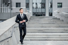 Cheerful young businessman. Mature man in formalwear standing on Royalty Free Stock Photography