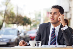 Cheerful young businessman is relaxing in Royalty Free Stock Photos