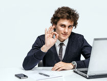 Cheerful young businessman showing Its Okay. Stock Image