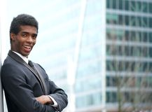 Cheerful young businessman smiling in the city Royalty Free Stock Images