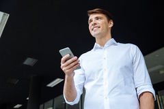 Cheerful young businessman using mobile phone Stock Photos