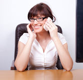 Cheerful young businesswoman chatting Stock Photography