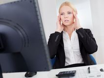 Cheerful young businesswoman with headache Stock Images