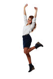 Cheerful young businesswoman jumping with arms up Royalty Free Stock Photos