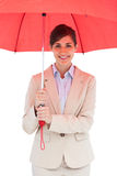 Cheerful young businesswoman with red umbrella Stock Photography