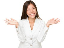 Cheerful Young Businesswoman Shrugging Royalty Free Stock Photos