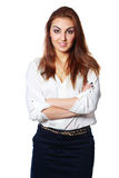 Cheerful young businesswoman standing with arms folded Royalty Free Stock Photography