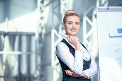 Cheerful young businesswoman is working on new Royalty Free Stock Images