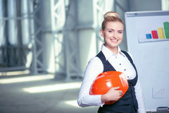 Cheerful young businesswoman is working on plan of Royalty Free Stock Image