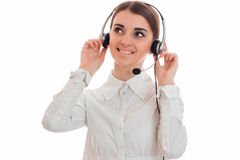 Cheerful young call center office girl with headphones and microphone smiling isolated on white background Royalty Free Stock Photos