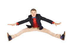 Cheerful young casual man jumping in air. And screaming with hand Royalty Free Stock Photography