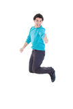 Cheerful young casual man jumping in air showing thumb up Royalty Free Stock Photography