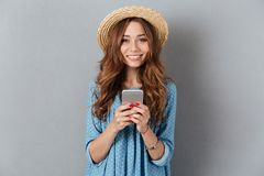 Cheerful young caucasian lady chatting by phone. Image of cheerful young caucasian lady chatting by phone. Looking camera Stock Images