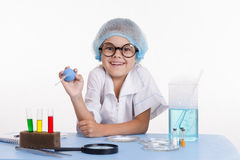 Cheerful young chemist Royalty Free Stock Photo