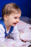 Cheerful young child in bed Royalty Free Stock Photography