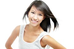 Cheerful young chinese girl with windswept hair. Happy, cheerful young chinese lady with windswept hair and dressed in white, isolated against white Stock Photos