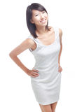 Cheerful young Chinese lady. Happy, cheerful young chinese woman in white. Clipping path provided Royalty Free Stock Images