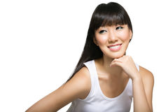 Cheerful young chinese lady with long silky hair. Happy, cheerful young chinese lady with long, silky hair and dressed in white Royalty Free Stock Images