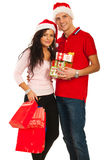 Cheerful young Christmas couple Stock Images