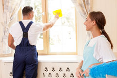 Cheerful young cleaners are cleaning a house Stock Photography