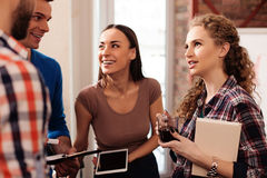 Cheerful young colleagues are sharing their ideas Royalty Free Stock Photo