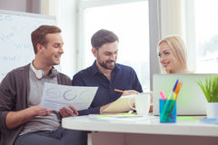 Cheerful young colleagues are working in cooperation Royalty Free Stock Photography