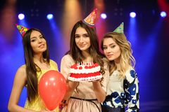 Cheerful young company celebrates birthday in a nightclub royalty free stock images