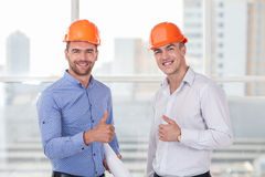 Cheerful young construction team are expressing Stock Photos