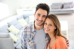 Cheerful young couple in brand new home Royalty Free Stock Images
