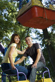 Cheerful young couple on the carousel Royalty Free Stock Photography